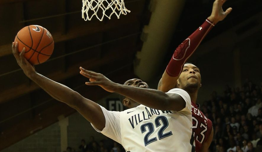 Villanova forward JayVaughn Pinkston (22) drives to the basket past Temple forward Devontae Watson (23) in the first half of an NCAA college basketball game, Sunday, Dec. 14, 2014, in Villanova, Pa. (AP Photo/Laurence Kesterson)