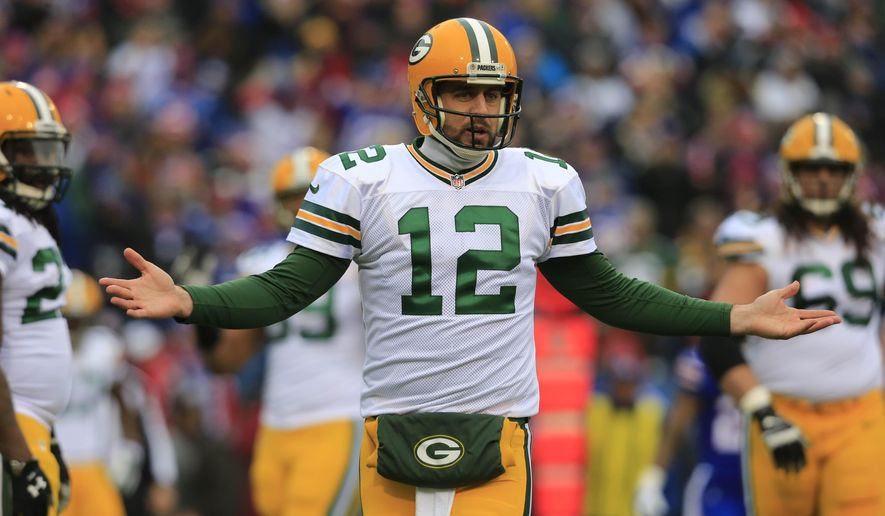 Green Bay Packers quarterback Aaron Rodgers (12) gestures to the sidelines during the first quarter against the Buffalo Bills on Sunday, Dec. 14, 2014, in Orchard Park, N.Y.  (AP Photo/The Buffalo News, Harry Schull, Jr.)  TV OUT; MAGS OUT; MANDATORY CREDIT; BATAVIA DAILY NEWS OUT; DUNKIRK OBSERVER OUT; JAMESTOWN POST-JOURNAL OUT; LOCKPORT UNION-SUN JOURNAL OUT; NIAGARA GAZETTE OUT; OLEAN TIMES-HERALD OUT; SALAMANCA PRESS OUT; TONAWANDA NEWS OUT