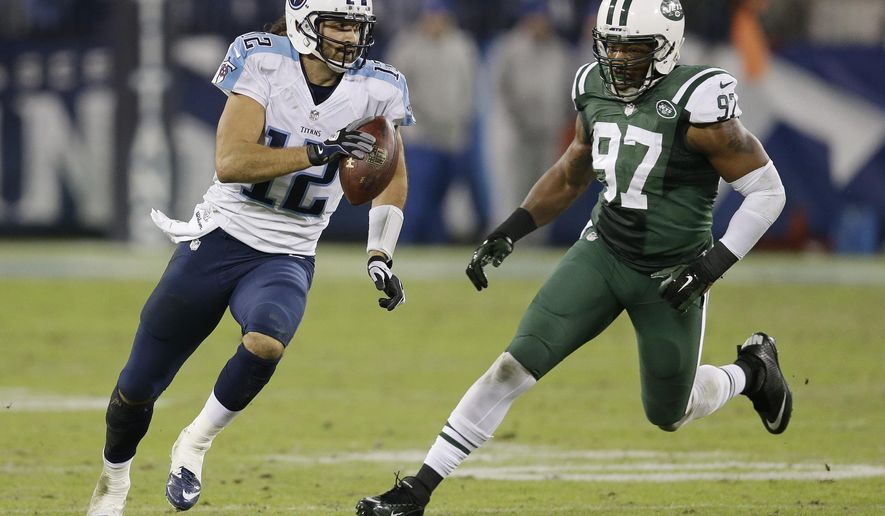 Tennessee Titans quarterback Charlie Whitehurst (12) scrambles away from New York Jets outside linebacker Calvin Pace (97) on the final play of the fourth quarter in an NFL football game Sunday, Dec. 14, 2014, in Nashville, Tenn. The Jets won 16-11. (AP Photo/James Kenney)