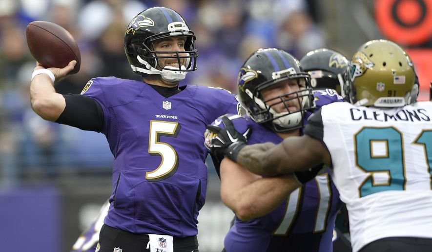 Baltimore Ravens quarterback Joe Flacco (5) passes the ball during the first half of an NFL football game against the Jacksonville Jaguars in Baltimore, Sunday, Dec. 14, 2014. (AP Photo/Nick Wass)