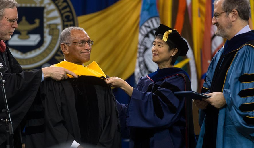 Charles F. Bolden Jr. receives his Honorary Doctorate in Science during the University of Michigan's Winter Commencement ceremony at the Crisler Center  in Ann Arbor, Mich., on Sunday, Dec. 14, 2014. (AP Photo/The Ann Arbor News, Tyler Stabile)