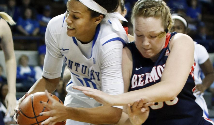 Kentucky's Azia Bishop, left, and Belmont's Sally McCabe battle for a rebound during the first half of an NCAA college basketball game, Sunday, Dec. 14, 2014, in Lexington, Ky. (AP Photo/James Crisp)