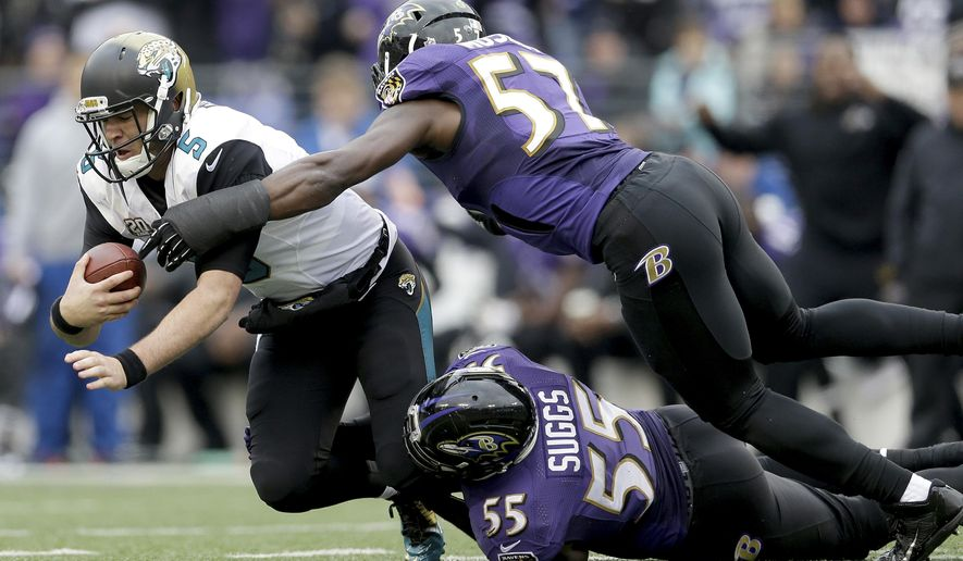 Jacksonville Jaguars quarterback Blake Bortles (5) is sacked by Baltimore Ravens inside linebacker C.J. Mosley (57) and outside linebacker Terrell Suggs (55) during the first half of an NFL football game in Baltimore, Sunday, Dec. 14, 2014. (AP Photo/Patrick Semansky)