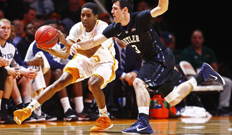 Butler guard Alex Barlow (3) attempts too steal the ball from Tennessee guard Detrick Mostella (15) in the first half of an NCAA college basketball game on Sunday, Dec. 14, 2014, in Knoxville, Tenn. (AP Photo/Wade Payne)