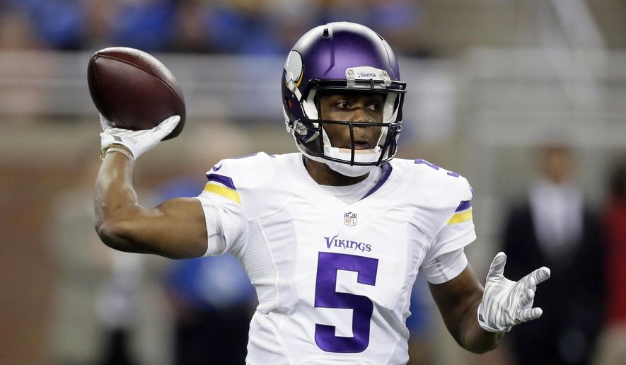Minnesota Vikings quarterback Teddy Bridgewater throws during the first half of an NFL football game against the Detroit Lions at Ford Field in Detroit, Sunday, Dec. 14, 2014. (AP Photo/Duane Burleson)