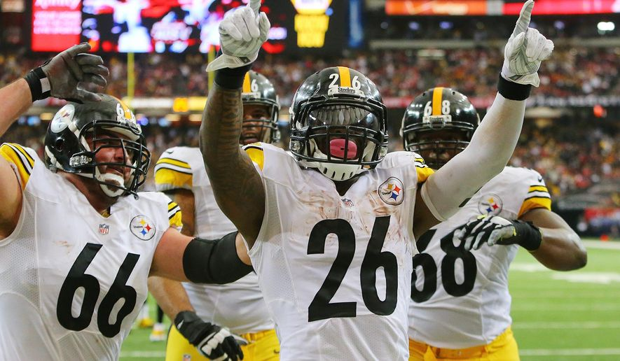 Pittsburgh Steelers running back Le'Veon Bell (26) celebrates his short touchdown run against the Falcons in the final minute of the first half of the NFL football game on Sunday, Dec. 14, 2014, in Atlanta.  (AP Photo/Atlanta Journal-Constitution, Curtis COmpton)  MARIETTA DAILY OUT; GWINNETT DAILY POST OUT; LOCAL TELEVISION OUT; WXIA-TV OUT; WGCL-TV OUT