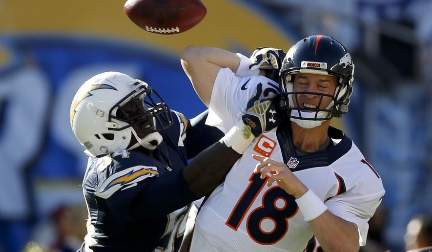 San Diego Chargers outside linebacker Melvin Ingram, left, knocks a pass way from Denver Broncos quarterback Peyton Manning during the first half of an NFL football game Sunday, Dec. 14, 2014, in San Diego. (AP Photo/Lenny Ignelzi)