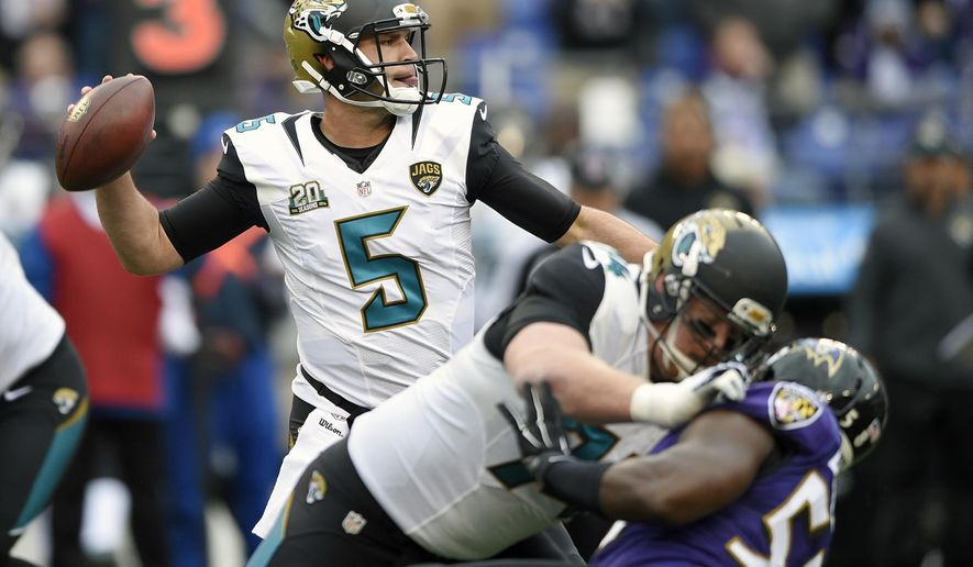 Jacksonville Jaguars quarterback Blake Bortles (5) passes the ball during the first half of an NFL football game against the Baltimore Ravens in Baltimore, Sunday, Dec. 14, 2014. (AP Photo/Nick Wass)