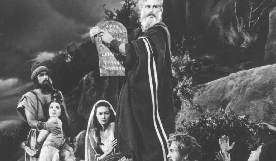 "Charlton Heston as Moses in a scene In the 1956 film ""The Ten Commandments."" (AP Photo/American Movie Classics, FILE)"