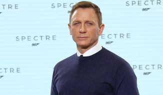 Actor Daniel Craig poses for photographers at the announcement for the new Bond film, the 24th in the series, at Pinewood Studios in west London on Dec. 4, 2014. (Joel Ryan/Invision/Associated Press)