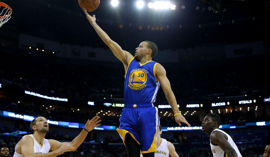 Golden State Warriors guard Stephen Curry (30) shoots over New Orleans Pelicans forward Ryan Anderson, left, and guard Jrue Holiday, right, during the first half of an NBA basketball game in New Orleans, Sunday, Dec. 14, 2014. (AP Photo/Jonathan Bachman)