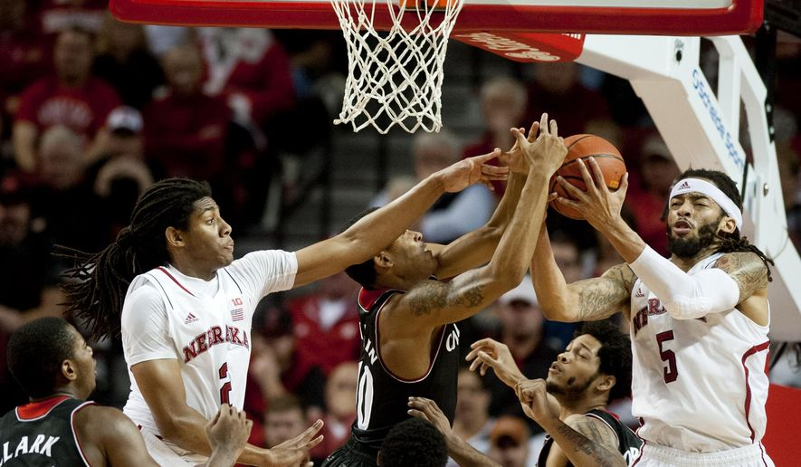 Nebraska's Terran Petteway (5) wins the rebound against Cincinnati's Troy Caupain (10) alongside Nebraska's David Rivers (2) during an NCAA college basketball game, Saturday, Dec. 13, 2014 in Lincoln, Neb. (AP Photo/The Journal-Star, Kaylee Everly) LOCAL TELEVISION OUT; KOLN-TV OUT; KGIN-TV OUT; KLKN-TV OUT