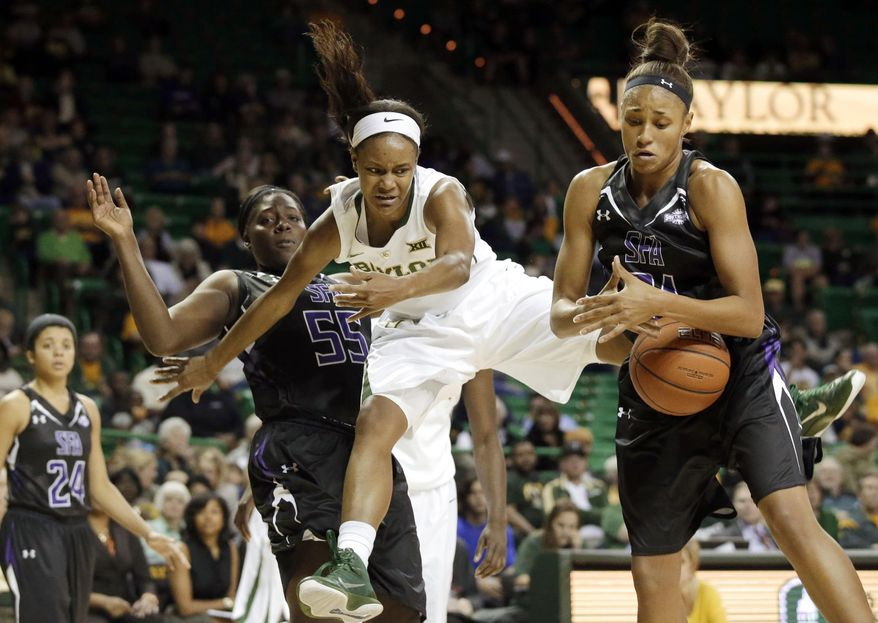 Baylor forward Nina Davis, center, is fouled by Stephen F. Austin center Adrienne Lewis (55) as Tierany Henderson, right, collects the loose ball in the second half of an NCAA college basketball game, Sunday, Dec. 14, 2014, in Waco, Texas. Davis had 33-points in the 96-57 Baylor win. (AP Photo/Tony Gutierrez)