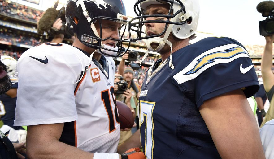 Denver Broncos quarterback Peyton Manning (18), left, shakes hands with San Diego Chargers quarterback Philip Rivers (17) after an NFL football game Sunday, Dec. 14, 2014, in San Diego. The Broncos won 22-10. (AP Photo/Denis Poroy)