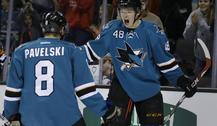 San Jose Sharks' Tomas Hertl, right, celebrates with Joe Pavelski (8) after Hertl scored a goal during the first period of an NHL hockey game against the Nashville Predators Saturday, Dec. 13, 2014, in San Jose, Calif. (AP Photo/Ben Margot)