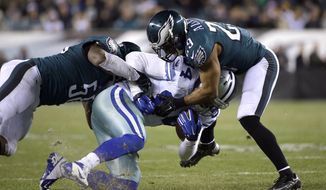 Dallas Cowboys' James Hanna (84) is tackled by Philadelphia Eagles' Trent Cole (58) and Nate Allen (29) during the second half of an NFL football game, Sunday, Dec. 14, 2014, in Philadelphia. (AP Photo/Michael Perez)