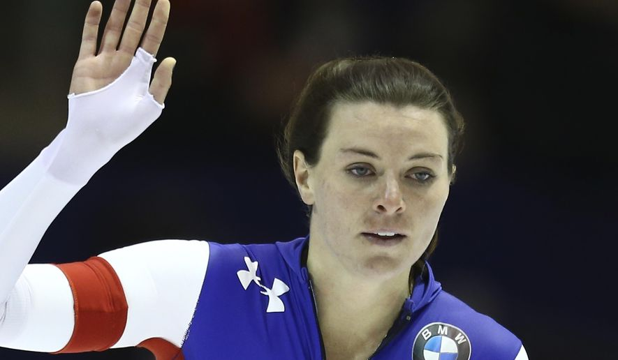 Heather Richardson of the U.S. greets spectators after competing on the women's 500 meters race of the World Cup Speed Skating at Thialf skating rink in Heerenveen, northern Netherlands, Sunday, Dec. 14, 2014. (AP Photo/Peter Dejong)