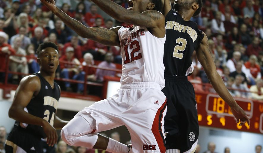N.C. State's Cat Barber (12) drives to the basket past Wofford's Karl Cochran (2) during an NCAA college basketball game in Raleigh, N.C., Sunday, Dec. 14, 2014.  (AP Photo/The News & Observer, Ethan Hyman)
