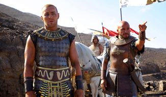 """This image released by 20th Century Fox shows Joel Edgerton, left, and Dar Salim in a scene from """"Exodus: Gods and Kings."""" Egypt has banned the movie. (AP Photo/20th Century Fox, Kerry Brown)"""