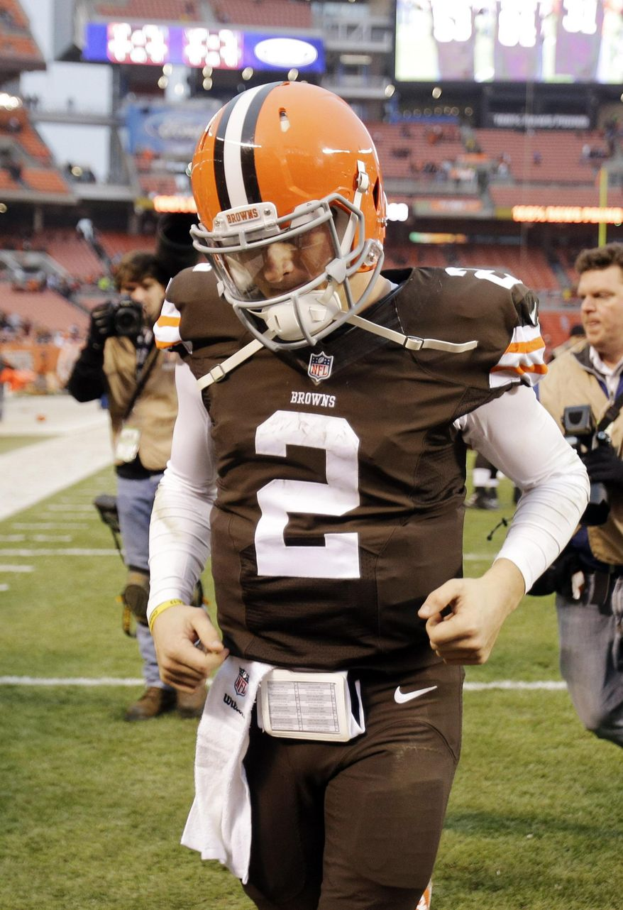 Cleveland Browns quarterback Johnny Manziel (2) runs off the field after a 30-0 loss to the Cincinnati Bengals in an NFL football game Sunday, Dec. 14, 2014, in Cleveland. (AP Photo/Tony Dejak)