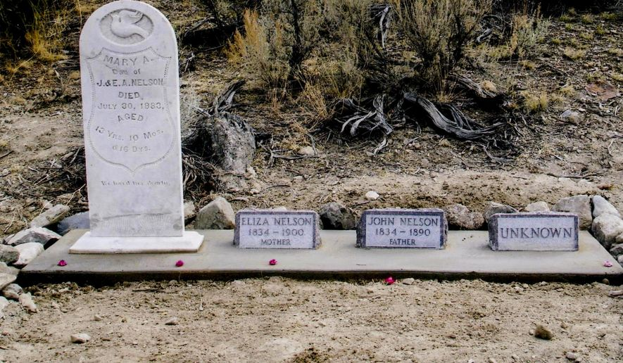 In this Nov. 3 2005 photo released courtesy of the Humboldt Museum shows the ornate headstone of Mary Nelson, that was restored in Pershing County, Nev. Over the decades, the Nelson family  graves have been repeatedly disturbed. Mary Nelson's headstone was repaired and restored to its former elegance. The graves of her mother and father were also marked. The identity of the fourth person is unknown, but some speculated it was John Nelson's brother, Vance Nelson. (AP Photo/Humboldt Museum)