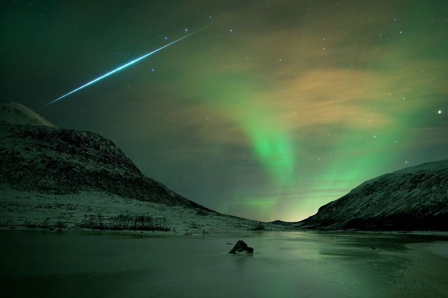 Nature's 'light show' is how NASA describes the Geminid meteor shower - a meteor flash is seen here with an aurora borealis shimmer in Norway. (NASA)