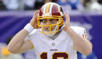 Washington Redskins quarterback Colt McCoy (16) calls an audible at the line of scrimmage during the first quarter of an NFL football game against the New York Giants, Sunday, Dec. 14, 2014, in East Rutherford, N.J. (AP Photo/Bill Kostroun)