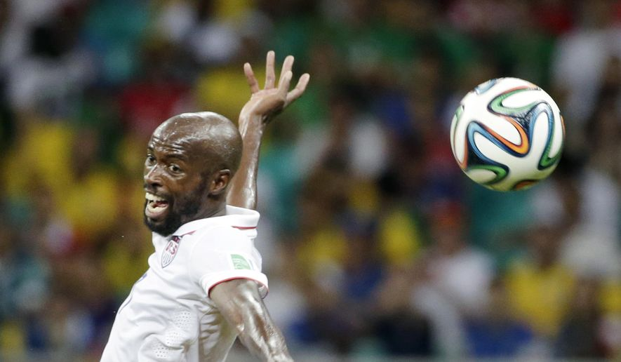 FILE - In a July 1, 2014 file photo United States' DaMarcus Beasley goes for the ball during the World Cup round of 16 soccer match between Belgium and the USA at the Arena Fonte Nova in Salvador, Brazil.  Beasley, the first American to play in four World Cups, says he is retiring from the U.S. national team after 14 years.   (AP Photo/Felipe Dana)