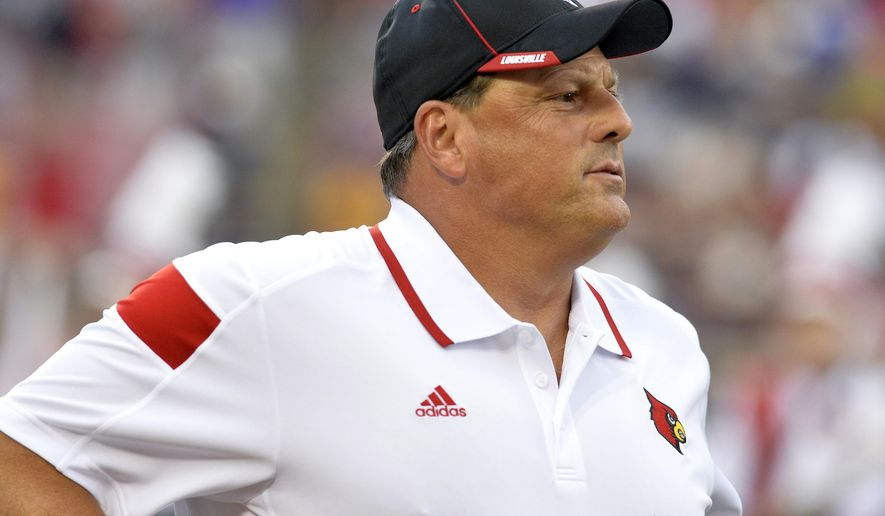 FILE - In this Sept. 6, 2014, file photo, Louisville defensive coordinator Todd Grantham watches his team go through warm ups before an NCAA college football game against Murray State in Louisville, Ky. Grantham is proud of the job he did at Georgia, and says it's no big deal to face the Bulldogs in the Belk Bowl. Grantham spoke Monday, Dec. 15, during a conference call with Georgia-based media. The No. 20 Cardinals (9-3) are set to meet the 13th-ranked Bulldogs (9-3) in the Dec. 30 game at Charlotte.  (AP Photo/Timothy D. Easley, File)