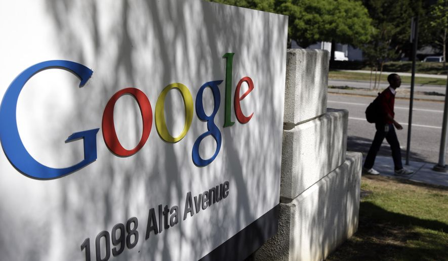 "File- In this June 5, 2014 file photo, a man walks past a Google sign at the company's headquarters in Mountain View, Calif.  Google is one of the major U.S. corporations researching the power of color in the working world, in everything from workspaces to marketing and branding. Meghan Casserly, spokeswoman for the organization built around the popular search engine, says Google has already found a clear link between color and satisfaction with a person's work area,"" which in turn can boost employee creativity and productivity.(AP Photo/Marcio Jose Sanchez, File)"
