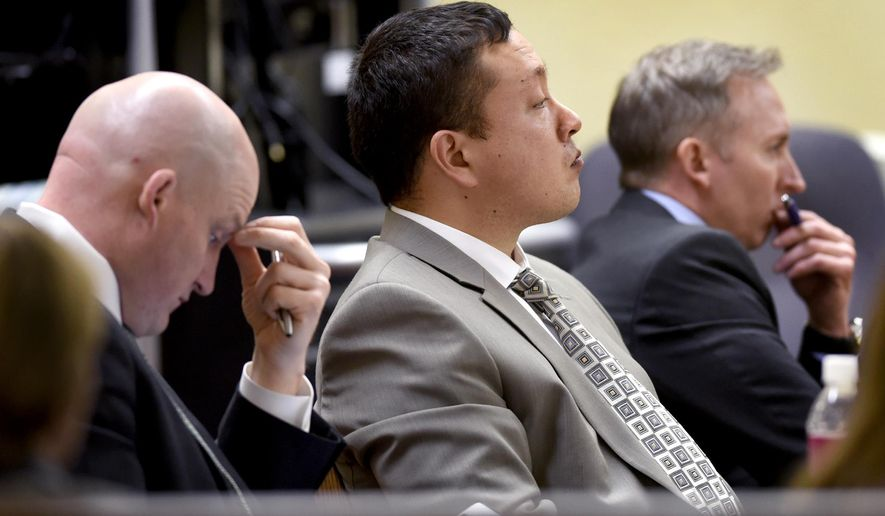 Flanked by his defense attorneys Brian Smith, left, and Paul Ryan, right, Markus Kaarma listens to testimony Monday, Dec. 8, 2014, during his trial in Missoula, Montana for murder in the shooting death of Diren Dede with a shotgun last spring after Kaarma caught Dede in his garage.  The defense says the shooting was in defense of himself and his family. (AP Photo/The Missoulian, Kurt Willson)