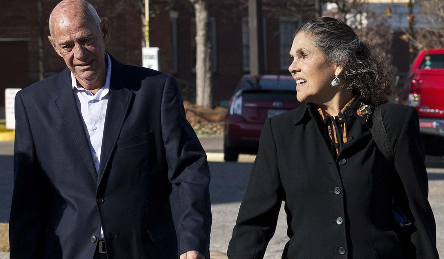 Lori Allen Siegelman, right, enters the Federal courthouse, Monday, Dec. 15, 2014, in Montgomery, Ala. Former Alabama Gov. Don Siegelman will be in federal court Monday for a hearing on his request to get out of prison while he appeals his 2006 bribery conviction. Siegelman is asking a federal judge to release him until his appeal to the 11th Circuit Court of Appeals is resolved. Man at left is unidentified. (AP Photo/Brynn Anderson)