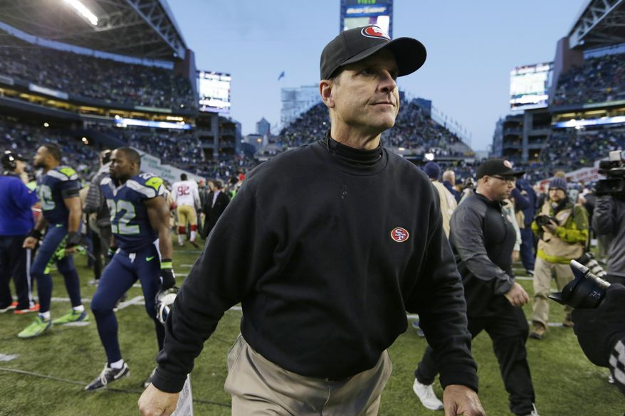 San Francisco 49ers head coach Jim Harbaugh walks off the field at the end of an NFL football game against the Seattle Seahawks, Sunday, Dec. 14, 2014, in Seattle. The Seahawks won 17-7. (AP Photo/John Froschauer)