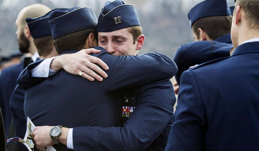 An Air Force member is comforted after the memorial service for fallen U.S. Air Force Capt. William DuBois at Rifle High School in Rifle, Colo., Sunday, Dec. 14, 2014.  DuBois was killed Dec. 1 when his F-16 jet crashed before he began the combat portion of his flight. (AP Photo/The Grand Junction Daily Sentinel, Dean Humphrey)