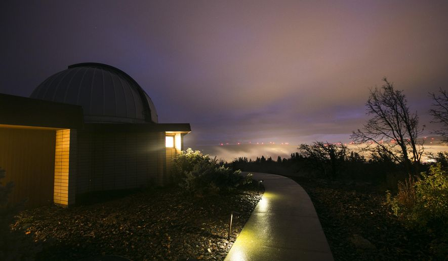 Light pollution from Goldendale, Wash. floods the sky on a cloudy night at the Goldendale Observatory State Park on Tuesday, Dec. 9, 2014. The observatory, run by the Washington State Parks, is a dark-sky destination for people from around the region, and is the only public observatory in the Northwest. (AP Photo/Yakima Herald-Republic, Mason Trinca)
