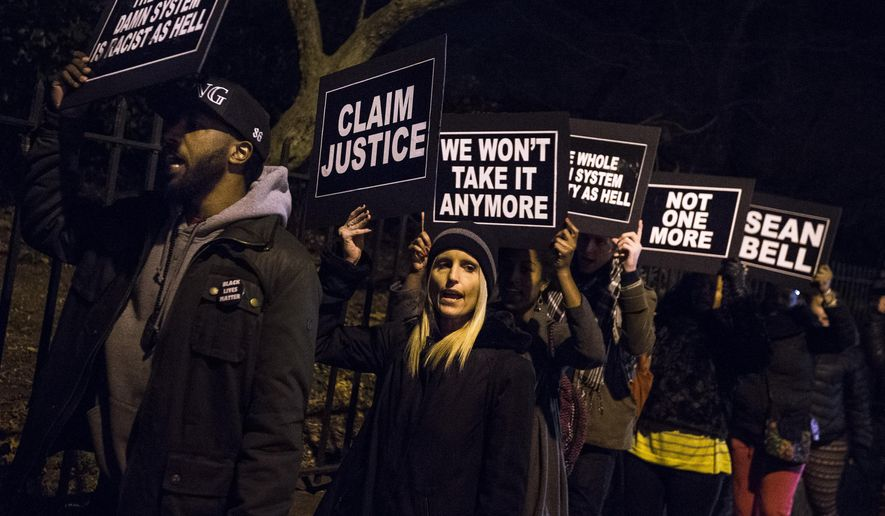 Protests chant as they rally outside Gracie Mansion as New York City Mayor Bill de Blasio hosts the annual holiday party, Monday, Dec. 15, 2014, in New York. (AP Photo/John Minchillo)