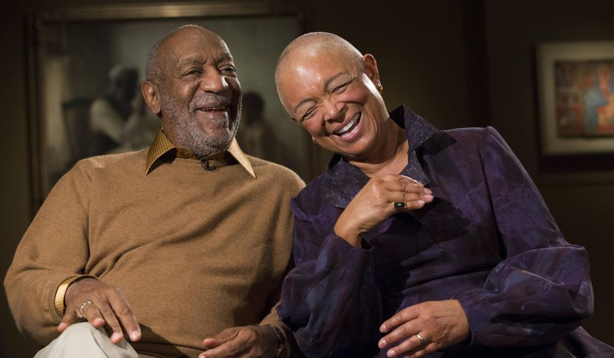 "FILE - In this Nov. 6, 2014 file photo, entertainer Bill Cosby and his wife Camille laugh as they tell a story about collecting one of the pieces in the upcoming exhibit, ""Conversations: African and African-American Artworks in Dialogue,"" at the Smithsonian's National Museum of African Art in Washington. Camille Cosby released a statement on Monday, Dec. 15, 2014 in support of her husband. The statement is the first public comment from Cosby's long-time wife since a wave of sexual assault allegations began swirling several weeks ago. (AP Photo/Evan Vucci, File)"