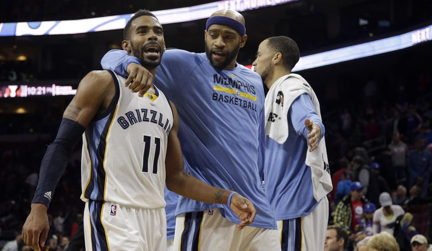 Memphis Grizzlies' Mike Conley, left, and Vince Carter celebrate after forcing a timeout during overtime of an NBA basketball game against the Philadelphia 76ers, Saturday, Dec. 13, 2014, in Philadelphia. Memphis won 120-115 in overtime. (AP Photo/Matt Slocum)