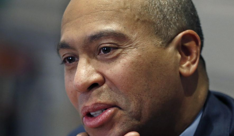 Massachusetts Gov. Deval Patrick speaks during an interview at his Statehouse office in Boston, Monday, Dec. 15, 2014. Patrick says he still has made no decisions about his future after leaving office. His final day as governor is Jan. 8.  (AP Photo/Elise Amendola)