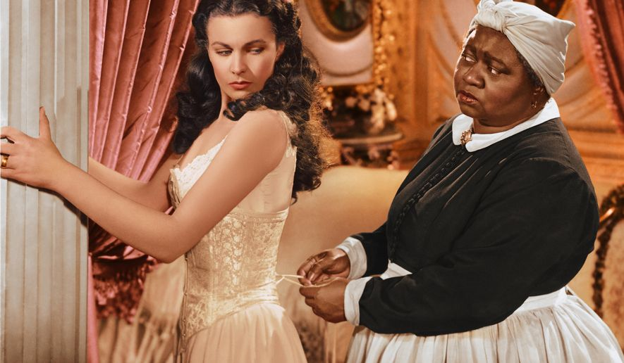 "In this image released by Turner Classic Movies, Vivien Leigh appears in character as Scarlett O'Hara, left, and Hattie McDaniel as Mammy, in the film, ""Gone with the Wind.""  75 years after the premiere of the movie, Gone with the Wind, research is shedding light on the racial tensions that existed at the time between the producer and City of Atlanta officials. Emory University film studies professor, Matthew Bernstein, has conducted extensive research into the archives of the film's producer, David O. Selznick. His findings illustrate some of Selznick's concerns with the city's treatment of the film's black stars at the Dec. 15, 1939 premiere. (AP Photo/Turner Classic Movies)"