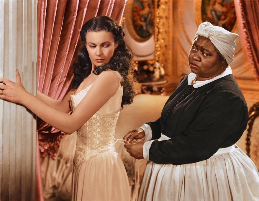"""In this image released by Turner Classic Movies, Vivien Leigh appears in character as Scarlett O'Hara, left, and Hattie McDaniel as Mammy, in the film, """"Gone with the Wind.""""  75 years after the premiere of the movie, Gone with the Wind, research is shedding light on the racial tensions that existed at the time between the producer and City of Atlanta officials. Emory University film studies professor, Matthew Bernstein, has conducted extensive research into the archives of the film's producer, David O. Selznick. His findings illustrate some of Selznick's concerns with the city's treatment of the film's black stars at the Dec. 15, 1939 premiere. (AP Photo/Turner Classic Movies)"""