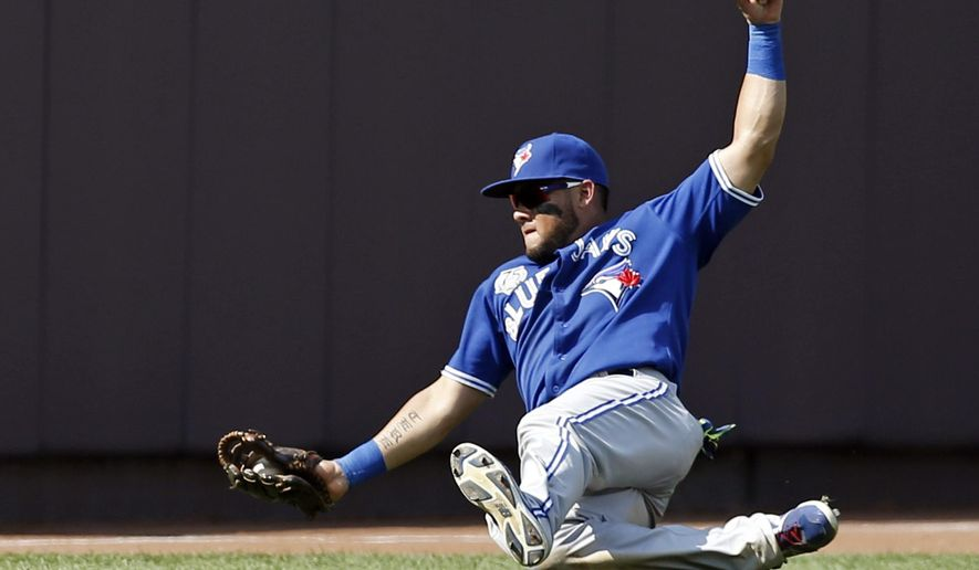 FILE - In this July 27, 2014, file photo, Toronto Blue Jays left fielder Melky Cabrera makes a sliding catch of Yankees' Ichiro Suzuki's ninth-inning flyout to deep left field in a baseball game at Yankee Stadium in New York. A person with direct knowledge of the deal says the Chicago White Sox have finalized a $42 million, three-year contract with free-agent outfielder Cabrera. The person spoke to The Associated Press on Monday, Dec. 15 on condition of anonymity because the team had not announced the agreement. (AP Photo/Kathy Willens, File)