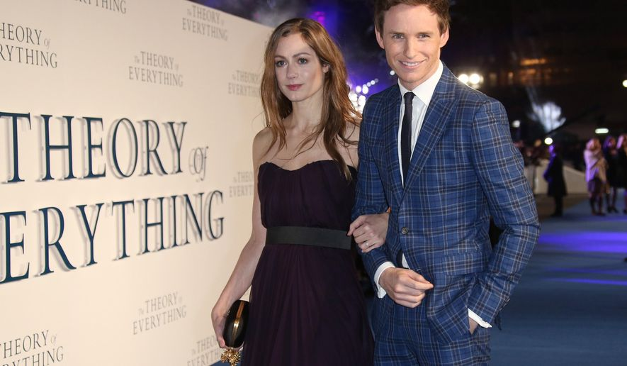 """FILE - In this Tuesday, Dec. 9, 2014 file photo, actor Eddie Redmayne and Hannah Bagshawe arrive on the blue carpet for the UK premiere of """"The Theory of Everything,"""" at the Odeon in Leicester Square, central London. Redmayne is celebrating more than his best-actor nominations this week. A spokeswoman for Redmayne says the actor married his girlfriend, Bagshawe, in a private ceremony in England, Monday, Dec. 15, 2014  (Photo by Joel Ryan/Invision/AP, File)"""