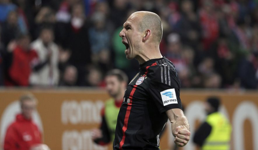 Bayern's Arjen Robben from the Netherlands celebrates after scoring his side's second goal during the German first division Bundesliga soccer match between FC Augsburg and FC Bayern Munich in the SGL Arena in Augsburg, Germany, on Saturday, Dec. 13, 2014. (AP Photo/Matthias Schrader)