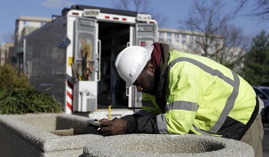 Dynamic Concepts Utility Locating Field Supervisor/Damage Investigator Lawrence Bowlding III takes notes outside the State Department in Washington, Monday, Dec. 15, 2014, where a power outage occurred. Authorities say an electrical transformer explosion has caused power outages at several government buildings in Washington. Most power at the State Department was lost and employees were told to work as best they could. Other buildings affected included the Federal Reserve, the General Services Administration, Metro's Smithsonian subway station, the Labor Department, the U.S. Park Police and the Federal Deposit Insurance Corp.  (AP Photo/Luis M. Alvarez)
