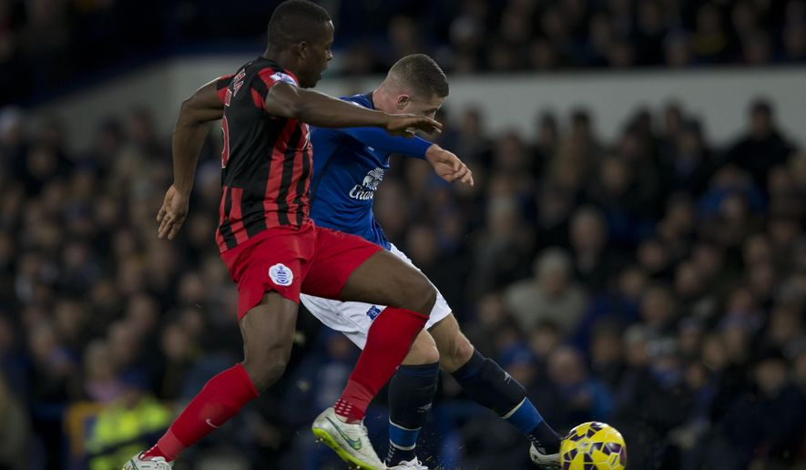 Everton's Ross Barkley, right, scores past Queens Park Rangers' Nedum Onuoha during the English Premier League soccer match between Everton and Queens Park Rangers at Goodison Park Stadium, Liverpool, England, Monday Dec. 15, 2014. (AP Photo/Jon Super)
