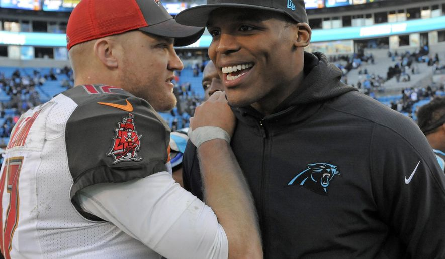 Carolina Panthers' Cam Newton, right, talks with Tampa Bay Buccaneers' Josh McCown, left, after an NFL football game in Charlotte, N.C., Sunday, Dec. 14, 2014. The Panthers won 19-17. (AP Photo/Mike McCarn)