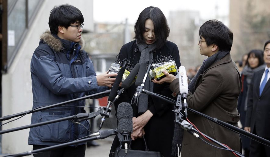 FILE - In this Friday, Dec. 12, 2014 file photo, Cho Hyun-ah, who was head of cabin service at Korean Air and the oldest child of Korean Air chairman Cho Yang-ho, speaks to the media upon her arrival for questioning at the Aviation and Railway Accident Investigation Board office of Ministry of Land, Infrastructure and Transport in Seoul, South Korea. Nut rage imploded the career of the Korean Air Lines executive and embarrassed her family and country. Now South Korean retailers are experiencing the unexpected upside: a boom in sales of macadamias. The flavorful macadamia nut was unfamiliar to many South Koreans until Cho ordered a flight attendant off a Dec. 5 flight from New York City after she was served them in a bag, instead of on a plate.  (AP Photo/Lee Jin-man, File)
