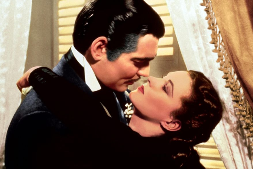 "Clark Gable, left, appears in character as Rhett Butler and Vivien Leigh as Scarlett O'Hara, in the film ""Gone with the Wind."" (AP Photo/Turner Classic Movies) ** FILE **"