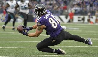 Baltimore Ravens tight end Owen Daniels (81) pulls in a 29-yard pass to set up a touchdown on the next play during the second half of an NFL football game against the Jacksonville Jaguars in Baltimore, Sunday, Dec. 14, 2014. The Ravens defeated the Jaguars 20-12. (AP Photo/Nick Wass)